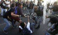 Mexican police charge down protesters against Enrique Peña Nieto, who has taken office as president.